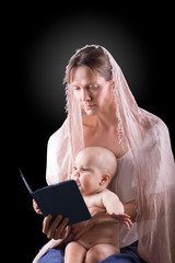 Mother reading book to her baby boy