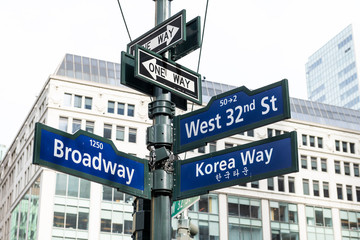 Manhattan NYC buildings of midtown near Korean Town, Korea Way road signs on west 32nd street, Broadway in New York City