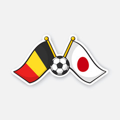 Sticker two crossed national flags of Belgium versus Japan with soccer ball between them