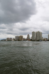 City with buildings and beach at the same time, city of Guaruja, beach South America, Brazil