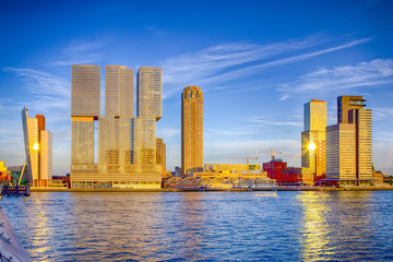 Travel Destinations. Sunny View of Rotterdam Port Cityscape Before the Sunset