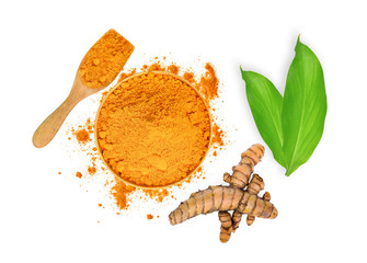 turmeric root and turmeric powder in wooden bowl and spoon with green leaves isolated on white...