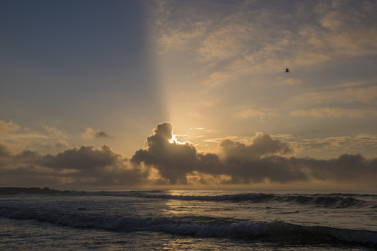 Beautiful sunrise at Asbury Park, on of the famous beaches in New Jersey featuring sun hidden behind the clouds