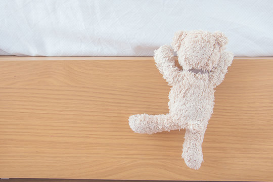 Teddy bear climbs on his bed ,He is naughty