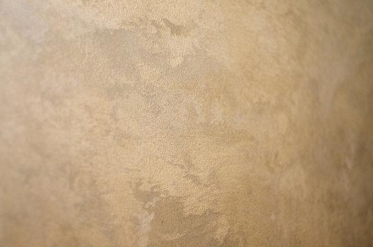 Silk decorative plaster. Texture. Selective focus.