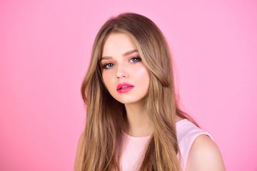 model with perfect long hair. model for fashion portrait with makeup on face.