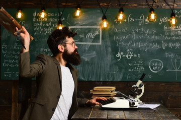 Bearded man throw briefcase. Man with beard typewrite research paper. Businessman in suit work at desk. Scientist in glasses with microscope and books. Future concept. innovation and archaism