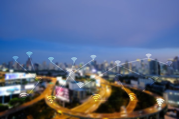WiFi network on blurred cityscape background.