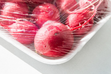 Red radish packed in a plastic bag
