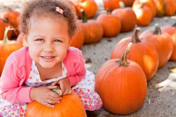 Little girl at a pumpking patch.