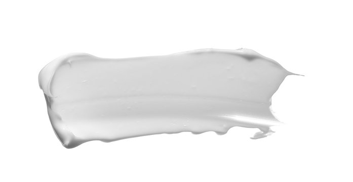White smear of cosmetic cream isolated on white
