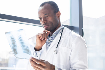 Attentive medical worker being in office
