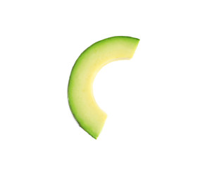 Slice of avocado on white background