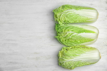 Fresh ripe cabbages on wooden background, top view