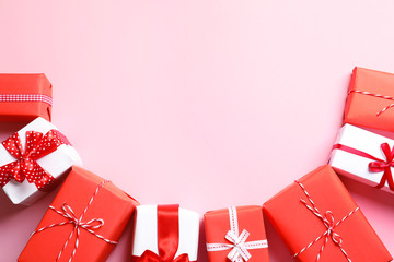Beautifully wrapped gift boxes on color background, top view