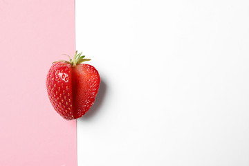 Fresh ripe strawberry on color background, top view