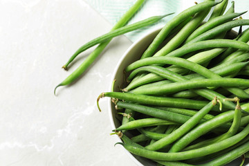 Bowl with fresh green French beans, closeup