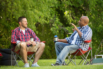 Friends talking and camping.