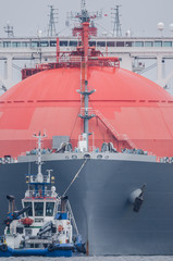 GAS CARRIER - A great tanker towed by a tugboat