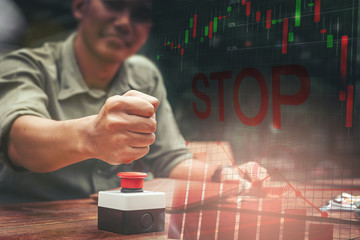 Businessman presses the emergency stop button for shut down the investment risk.