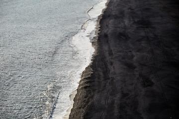 The Atlantic coast. Black sand