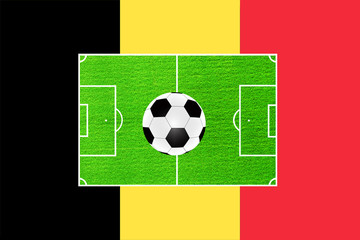 football on the background of the field and the flag of Belgium