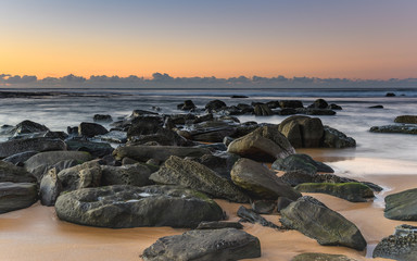 Rocky Shoreline and Sunrise