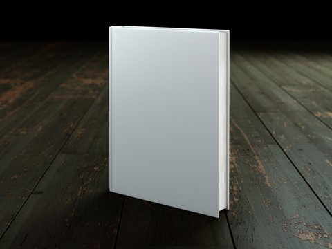 Blank hard cover book template on wood.