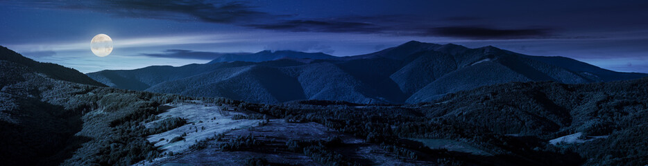 beautiful panorama of mountain ridge at night in full moon light. wonderful landscape in early autumn