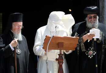Pope Francis' cape is blown by a gust of wind as he delivers a speech after a meeting with Patriarchs of the churches of the Middle East at the St. Nicholas Basilica in Bari