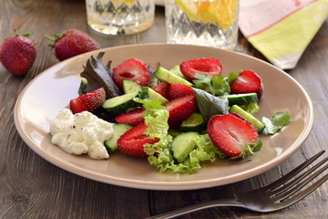 Strawberry salad with cucumber and  lettuce with yogurt sauce