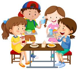 Group of children eating together