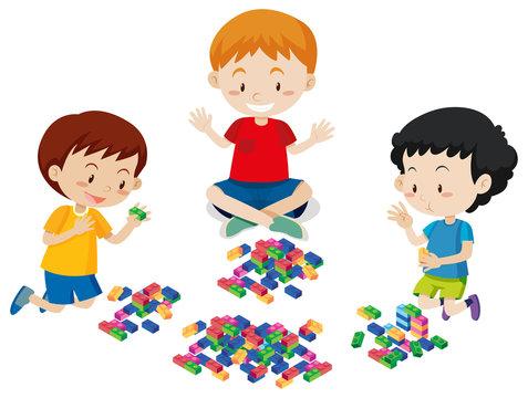 Boys Playing Lego on White Background