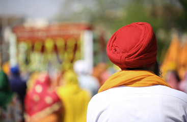 Sikh man with red turban outdoors