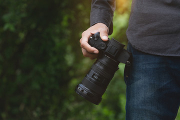 close-up on photographer hand holding camera