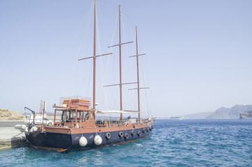 Wooden ship for trip in port  on Santorini island