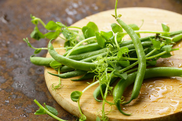 green organic beans and sprouts peas on the table