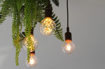 Four light bulbs hanging on the wooden ceilling.