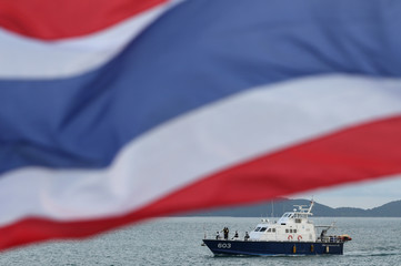 A rescue boat is seen during a search operation for missing passengers of a capsized tourist boat in Phuket