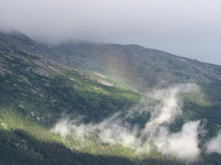 Mountain side with a rainbow