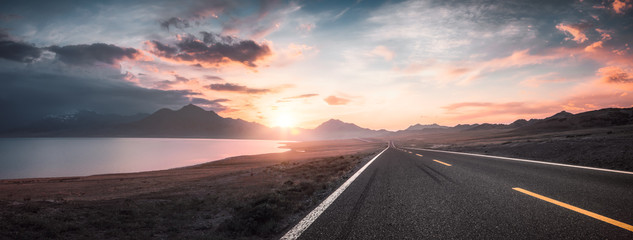 Lake and road  at sunset Wall mural