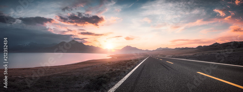 Wall mural Lake and road  at sunset