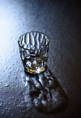 Abstract empty glass with shadow, black background