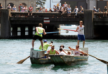 Participants use lances as they try to push each other from their boats during the traditional Schifferstechen event in Zurich