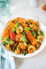 Red pesto chicken with spinach fusilli, seared red peppers and squash