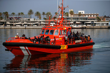 Migrants are seen on a rescue boat upon arrival at the port of Malaga