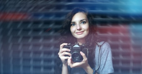 Happy girl with vintage camera film photo with light leaks