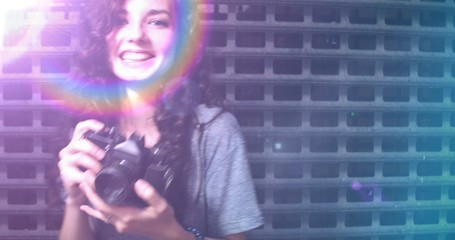 Used film photo shot of happy teenager photographer covered with raindow light leak, copyspace