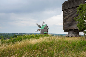 Old wooden windmill in the field.