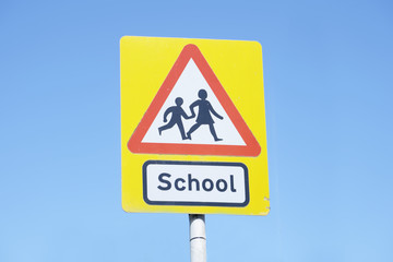 school warning sign blue sky red triangle road safety children young kids parents